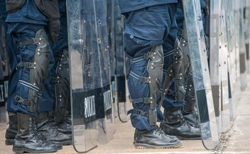 Policemen's legs in protective plates - image #304611 gratis
