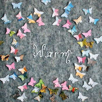 Paper butterflies around the word warm - image #305381 gratis