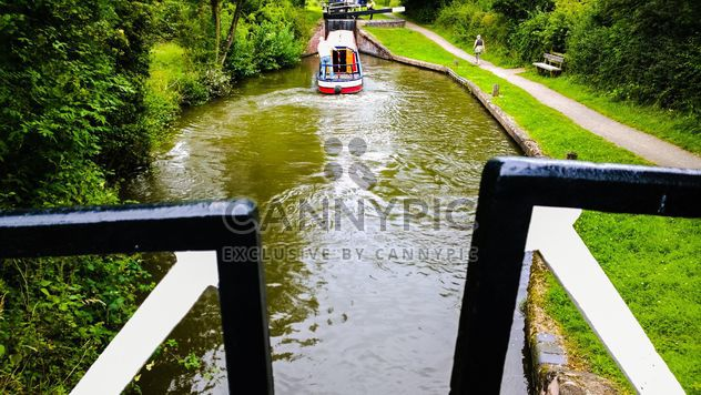 Boater tourist holidaymaker driving steering narrow boat - Free image #305701
