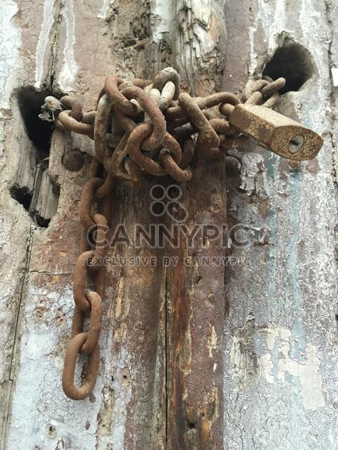 rusty lock on an old wooden door - Free image #317401