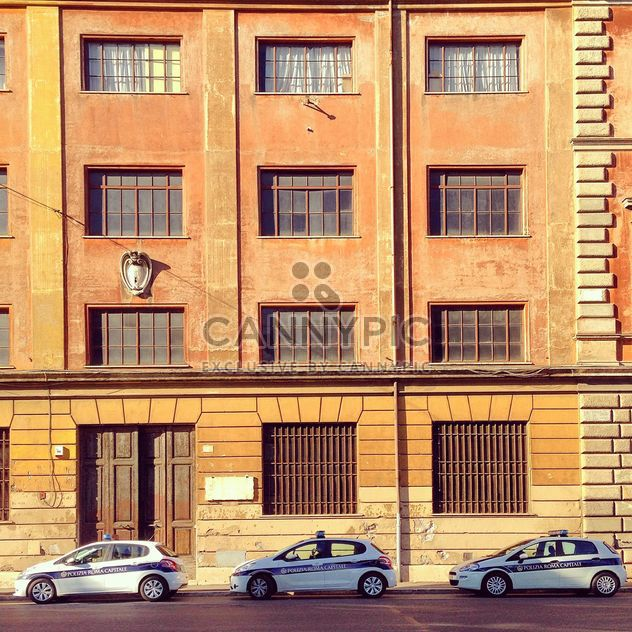 Police cars parked near building - Free image #331831