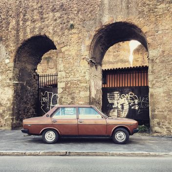 Brown Fiat 131 near old arch - image gratuit #331851