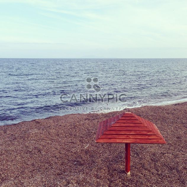 Wooden umbrella on seashore - Free image #332051