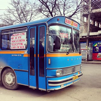 Blue bus on the street - image #332091 gratis