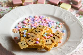 Toast bread decorated with beads and wooden letters - image #332771 gratis