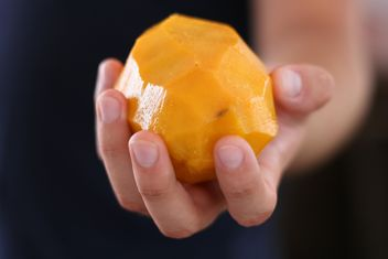 juicy peeled mango in the hand - бесплатный image #335051