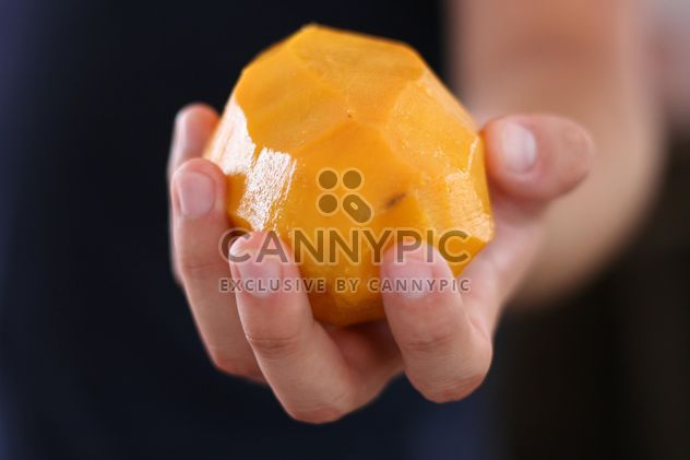 juicy peeled mango in the hand - image gratuit #335051