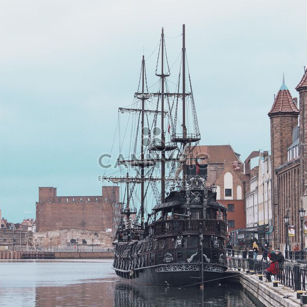 Medieval ship on pier of an old town - Free image #335271