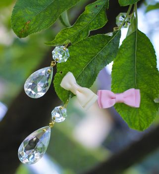 Bows and gems on green leaves - бесплатный image #337821