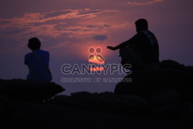 Silhouettes of people at sunset - Free image #338551