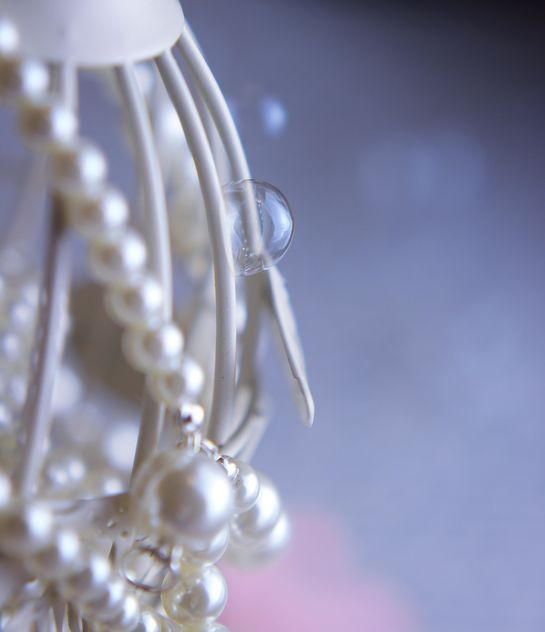 Close up of white bird cage decorated with pearls - бесплатный image #341481
