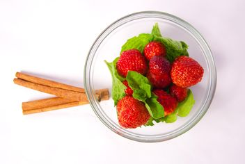 Fresh strawberry with mint and cinnamon on white background - бесплатный image #342511