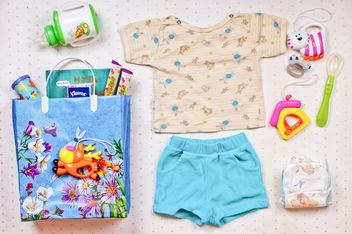 Baby's clothes and things on white background - image gratuit #343591