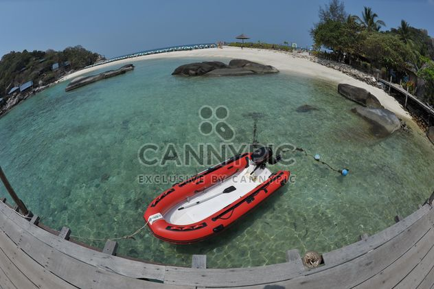 Red dinghy near the beach on Nangyuan lsland in thailand - Free image #344051