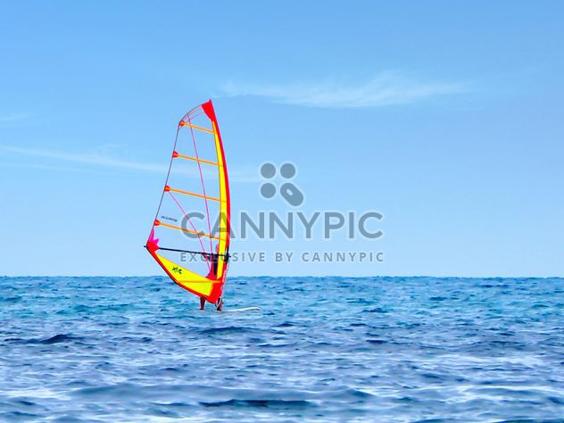 Windsurfer on sea under cloudless sky - Free image #344551