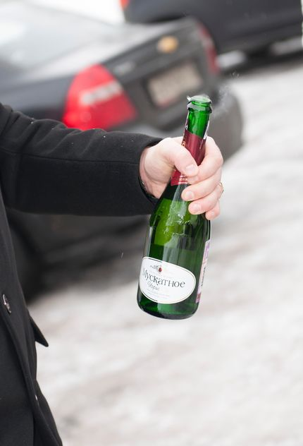 Bottle of champagne in male hand - бесплатный image #345041