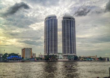Twin buildings on riverside of Chao Phaya River, Bangkok, Thailand - бесплатный image #346221