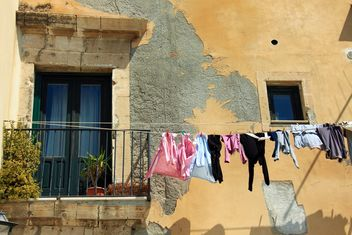 Laundry hanging on rope outside house - Free image #346251