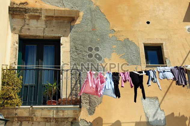 Laundry hanging on rope outside house - image gratuit #346251