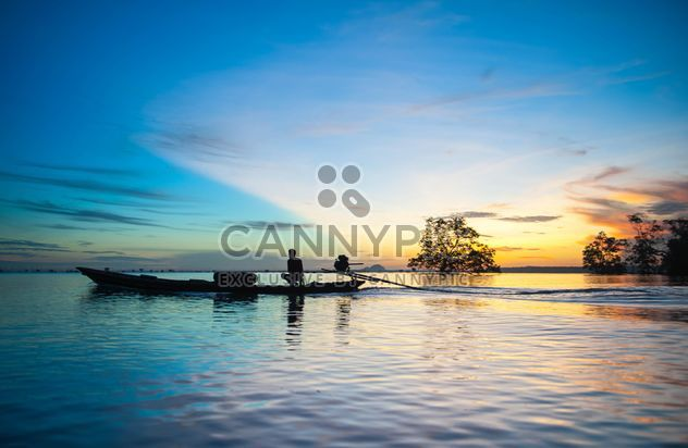 Fisherman in boat on sea in morning - Free image #347711