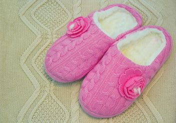 Warm pink slippers on knitted background - бесплатный image #347911