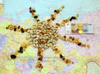 Pistachio nuts, candied fruit and money on map - бесплатный image #347921