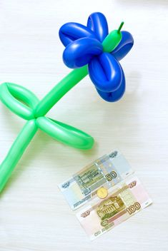 Balloon in shape of flower and money on white background - бесплатный image #347931