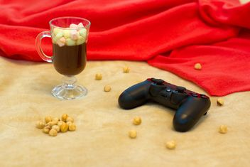 Hot cocoa with marshmallows and gamepad - бесплатный image #347981