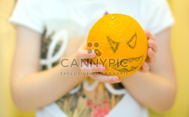 Angry orange for Halloween in child's hands - image gratuit #348011