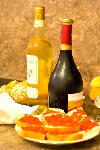 Sandwiches with red caviar and bottles of wine - Free image #348031