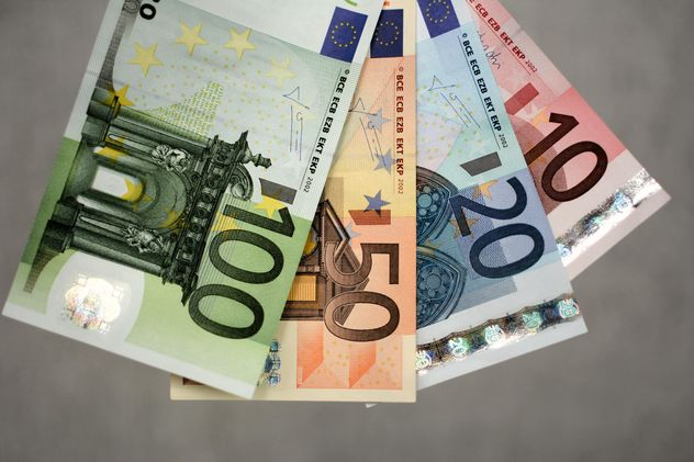 Closeup of Euro banknotes on grey background - бесплатный image #348391