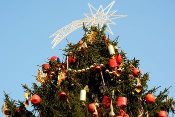 Decorated Christmas tree against blue sky - бесплатный image #348431