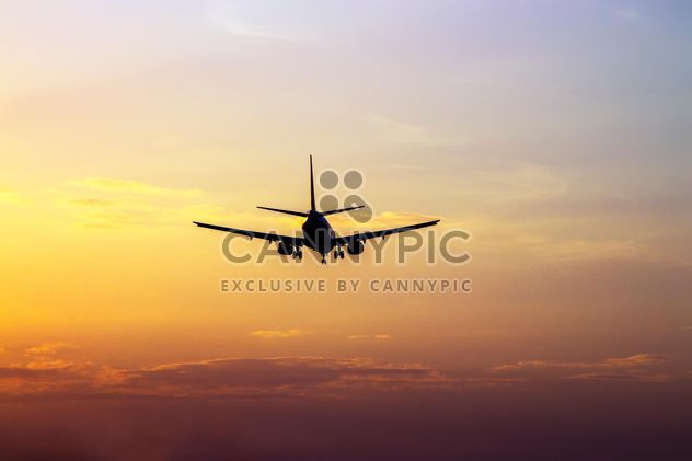 Airplane landing at sunset - Free image #350271