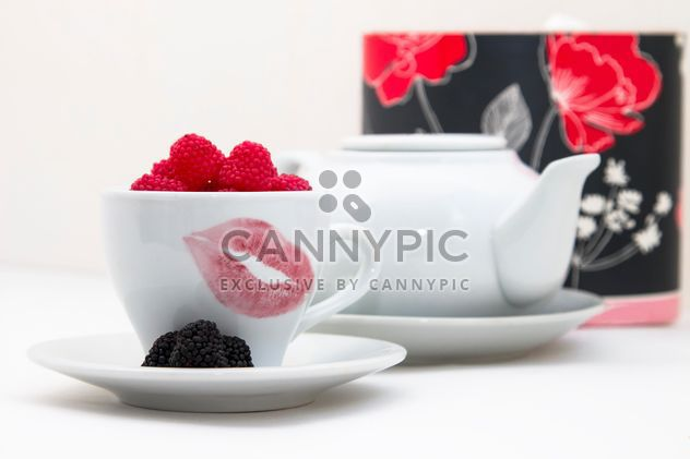Candies in white cup with trace of lips - Free image #350301