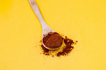 Red pepper spice on wooden spoon. Yellow background - Free image #448911