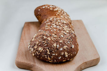 Grain bread with flax seeds and sesame, close up - бесплатный image #449091
