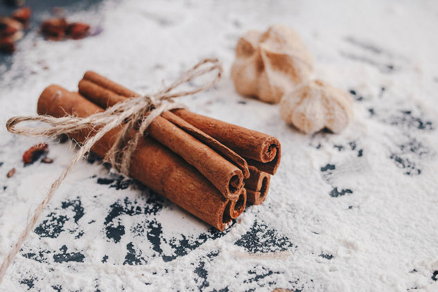 Cinnamon sticks in close up with flour background.jpg - Free image #450731