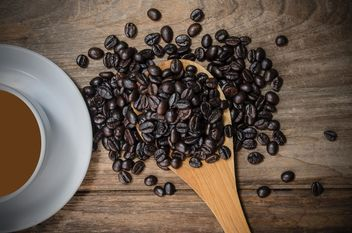 Cup of coffee and roasted coffee beans in spoon - бесплатный image #452451