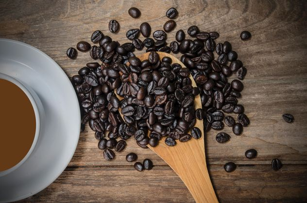 Cup of coffee and roasted coffee beans in spoon - image #452451 gratis