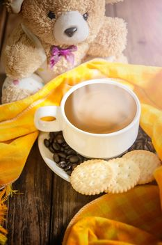 Cup of coffee with crackers, coffee beans and teddy bear - бесплатный image #452491