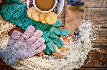 Warm accessories, cookies and cup of coffee over wooden background - бесплатный image #452501