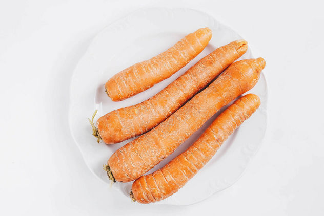 Top view of group of carrots on white background.jpg - image #452771 gratis