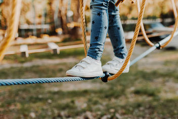 Young girl walking on rope in rope park. Legs detail - image #453721 gratis