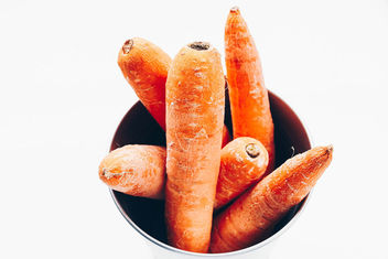 Top view of carrots in a bowl. White background . Close up - Free image #454241