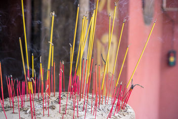 Burning Incense Sticks in a Sand filled Pot in Jade Emperor Pagoda in Saigon.jpg - Free image #457211