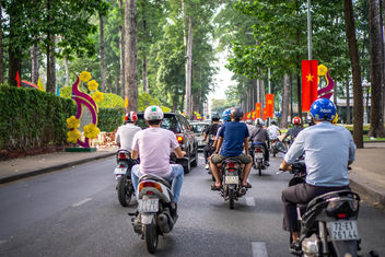 Vietnamese Flags and Tet Decorations along a Street in Saigon, Vietnam.jpg - image #458761 gratis