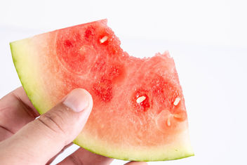 Sliced-Watermelon-in-the-hand-above-white-background.jpg - Free image #462451