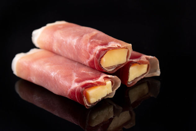 Rolled Pork Ham with yellow Cheddar cheese above black background (Flip 2019) - image gratuit #462571