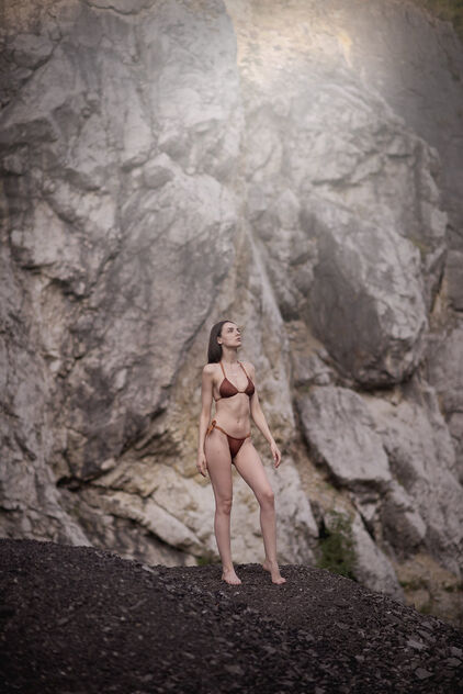 Young model in bikini posing near rocks outdoors. - image gratuit #473791